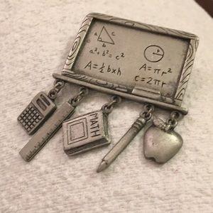 J.J. Pewter teacher motif pin 2 inches across